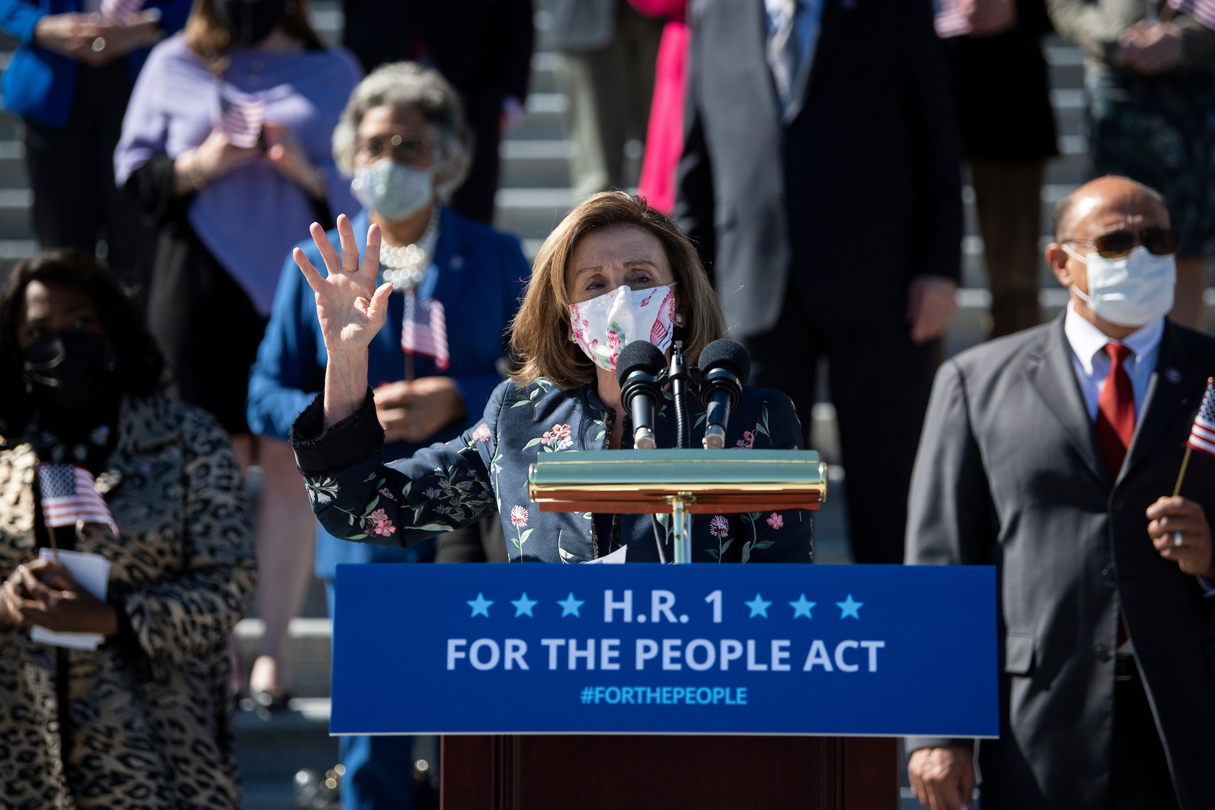 Speaker Nancy Pelosi talks at a news conference Wednesday with other House Democrats to discuss HR 1, which the chamber later passed 220-210. (Caroline Brehman/CQ Roll Call)
