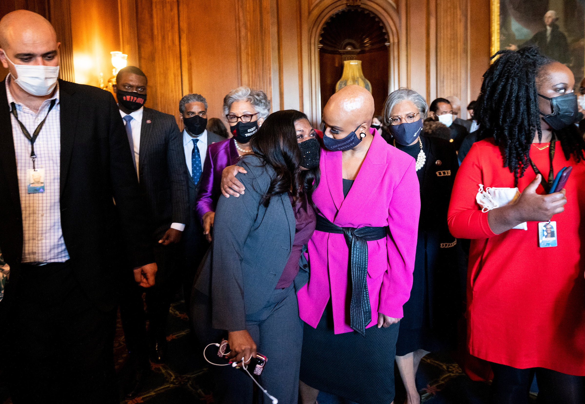 Rep. Cori Bush, D-Mo., left, hugs Rep. Ayanna Pressley, D-Mass., in the Rayburn Room in the U.S. Capitol after hearing three guilty verdicts in the Derek Chauvin trial on Tuesday. (Bill Clark/CQ Roll Call)