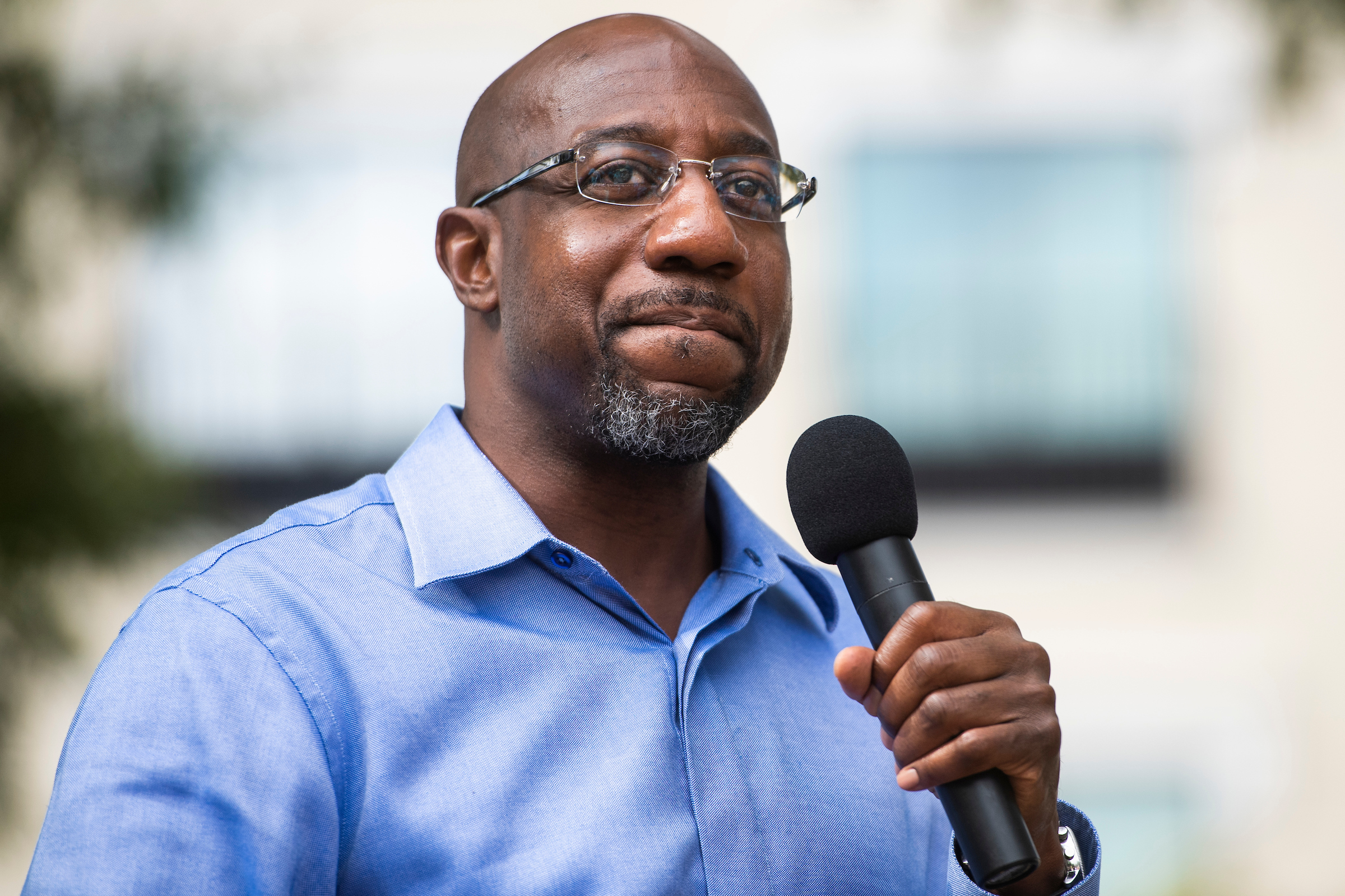 Raphael Warnock, shown here on the campaign trail last year, returns to Georgia most weekends to deliver his sermons, peppered with mentions of his work in the Senate. (Tom Williams/CQ Roll Call file photo)
