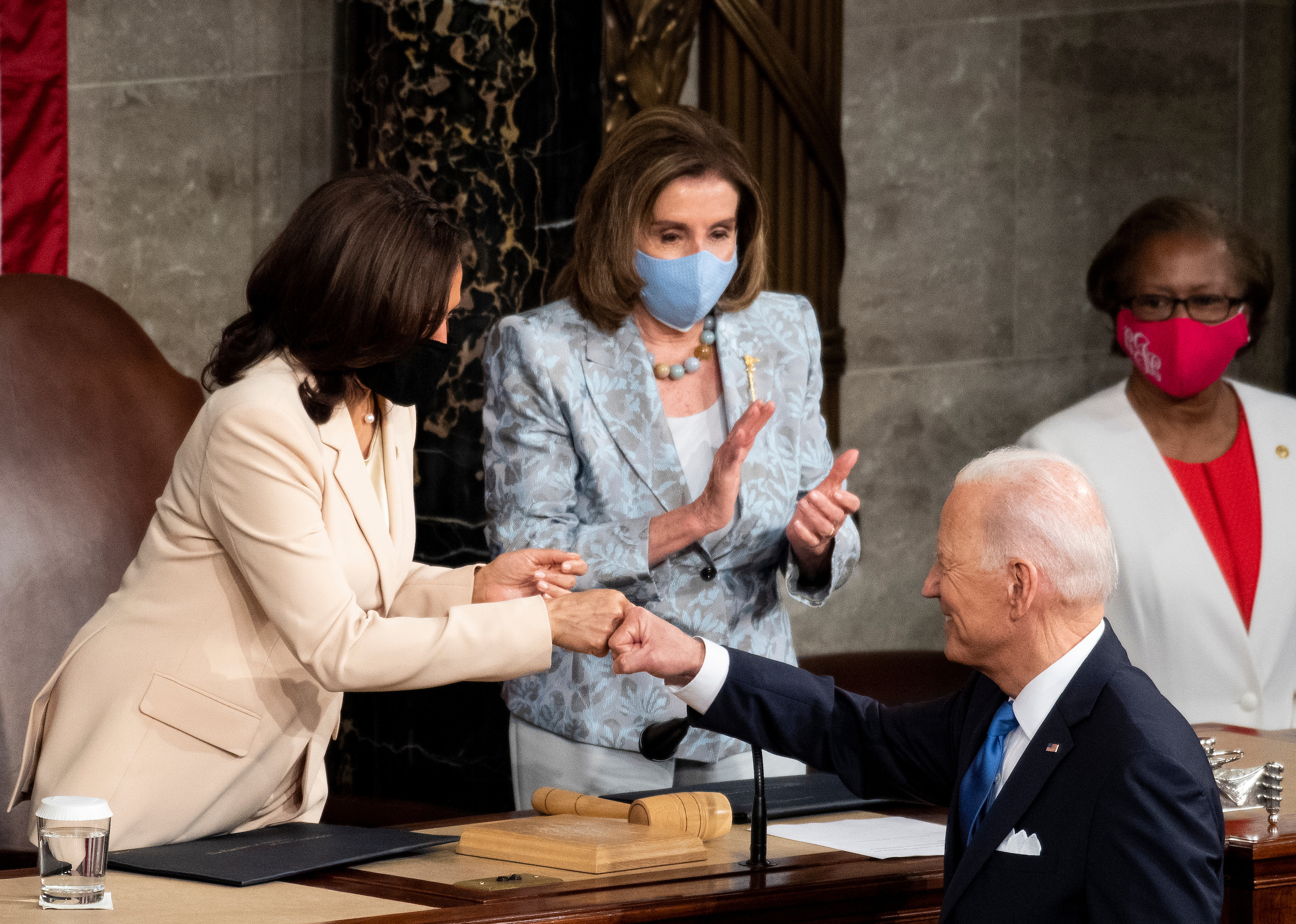 President Joe Biden fist-bumps Vice President Kamala Harris at his April 28 joint session address as Speaker Nancy Pelosi looks on. Voters may end up frowning on his expansive government agenda, Rothenberg writes.  (Caroline Brehman/CQ Roll Call)