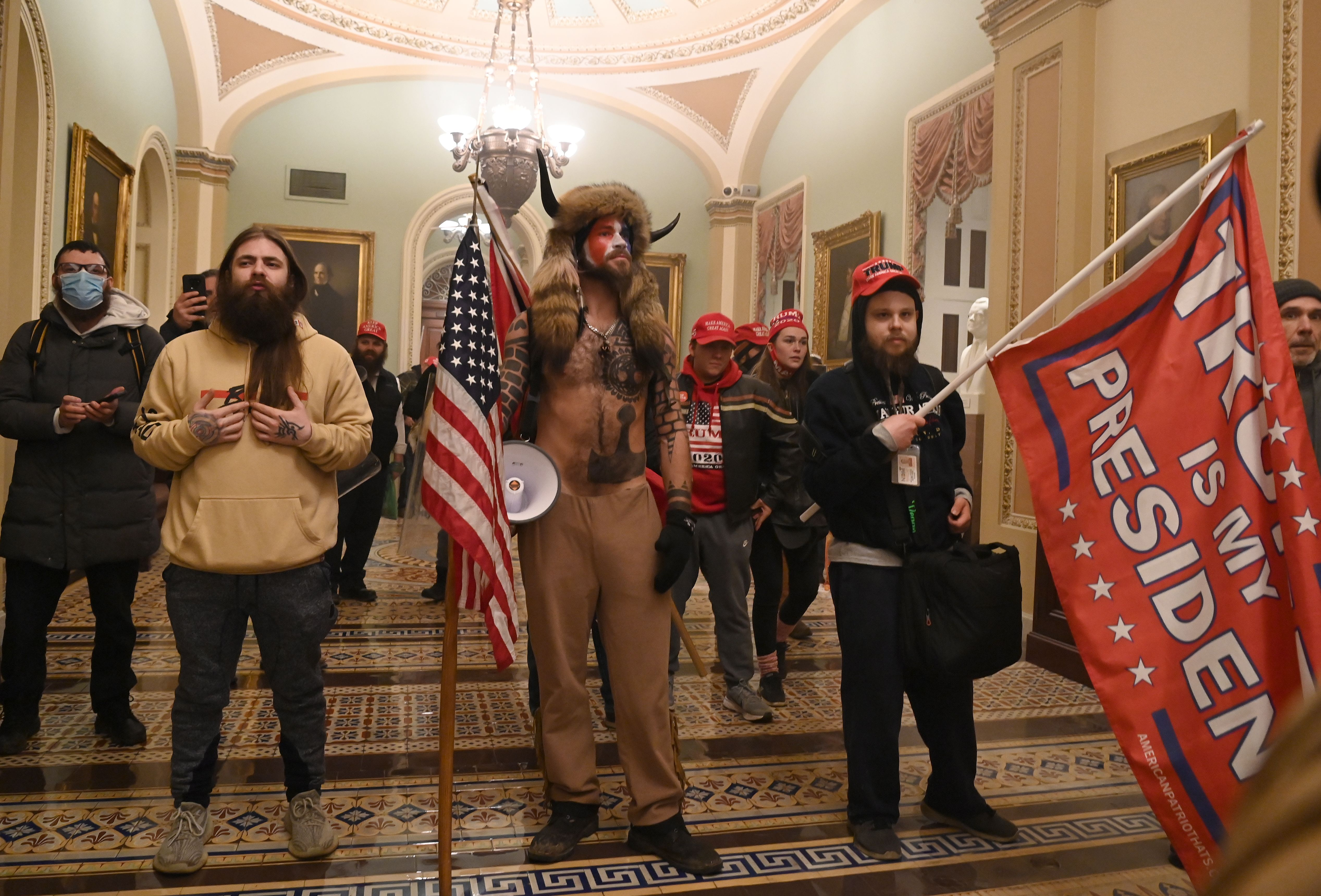 Jan 6 rioters including the so-called QAnon Shaman center feel protected today with American history and the GOP on their side ready to put treasonous insurrection in the rearview mirror Curtis writes  Saul LoebAFP via Getty Images file photo