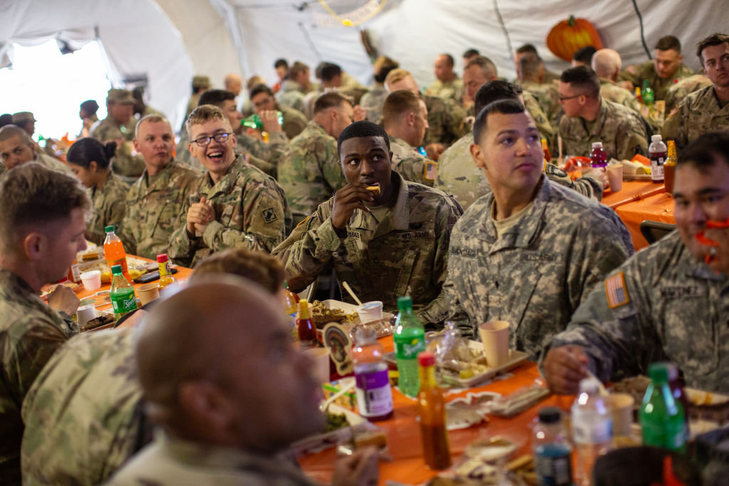Army troops deployed to the U.S.-Mexico border eat a Thanksgiving meal at a base near the Donna-Rio Bravo International Bridge on Nov. 22, 2018, in Donna, Texas. (Tamir Kalifa/Getty Images file photo)